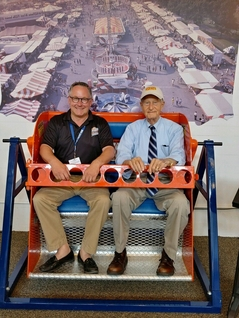 Marty Biniasz takes a ride on the Sky Wheel with E. James Strates of the famous Strates Shows