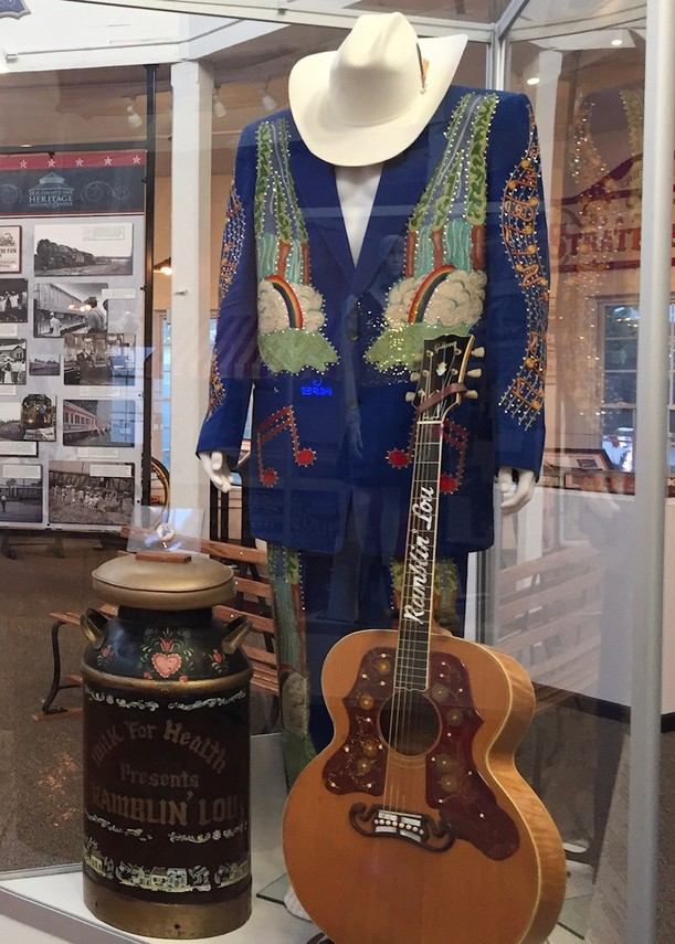 "2016 - A display dedicated to Ramblin' Lou Schriver included his ""Nudie Suit."" The stage outfit was made by Nuta Kotlyarenko, known professionally as Nudie Cohn"