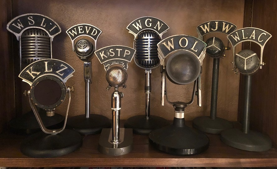 Collection of vintage radio station microphones from RCA, Western Electric, Electro Voice and Shure WSLI WGN WLAC WJW WOL WEVD KSTP